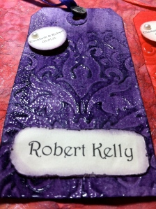 Purple Embossed Tag and Name Card.